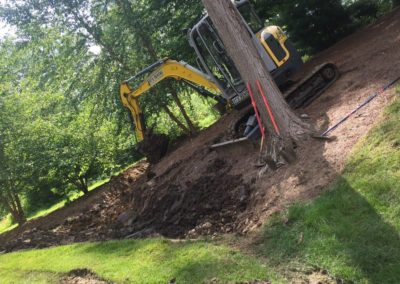 Digging trench for drainage rock bedRock bed dig